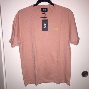 Salmon pink Stussy t shirt